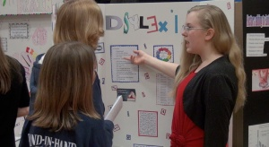 Faith talks about her science display.